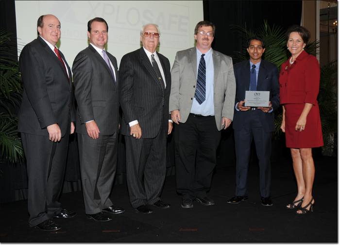 Dr. Allen Apblett and Shoaib Shaikh accept XploSafe's award as one of Oklahoma's Most Promising New Business Ventures